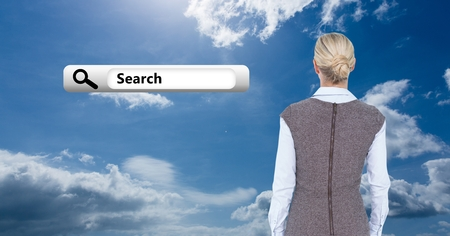 Digital generated rear view of business woman looking at search bar icon against cloudy sky