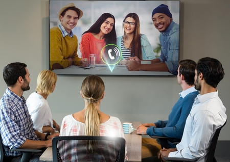 Business conference call on television in office Stock Photo