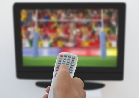 business pitch: Man using remote control to change channels at home