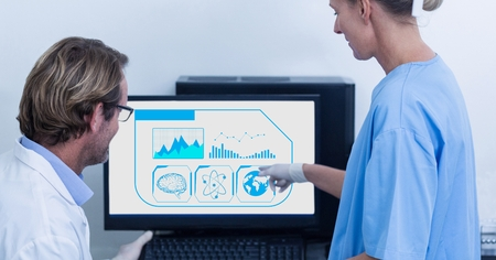 Surgeon pointing towards desktop pc at the hospital