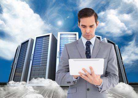 Digital composition of businessman using digital tablet against office building in background