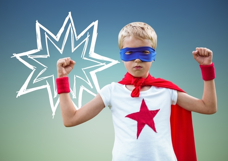 Digital composition of kid in superhero costume flexing his arms against green background Stock Photo