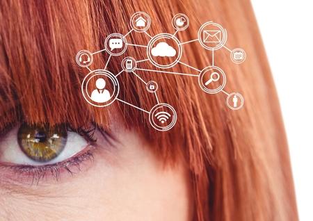 Eye of redhead woman looking at cloud computing digital interface Stock Photo
