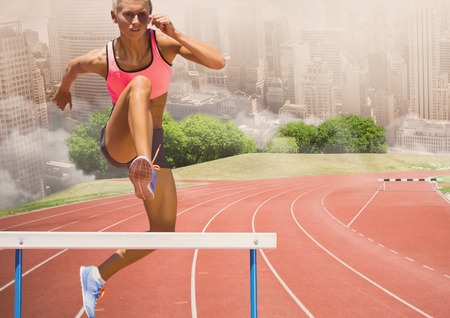Digital composite image of female athlete jumping above the hurdle against cityscape background