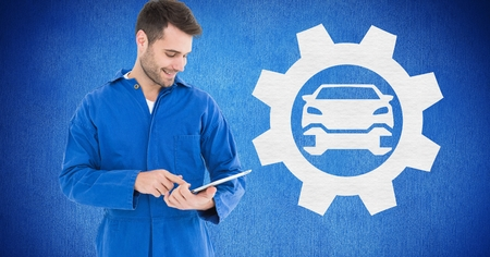 Digital composite of smiling mechanic using digital tablet against blue background