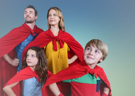 Composite image of super family wearing red cape standing with hand on hip against clear sky background