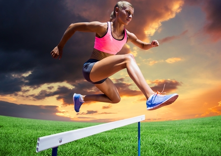 business pitch: Digital composite of athlete woman jumping over hurdle against cloudy sunset Stock Photo
