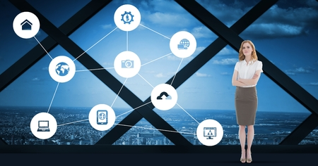 Digital composite of businesswoman standing with various application icon against cityscape background