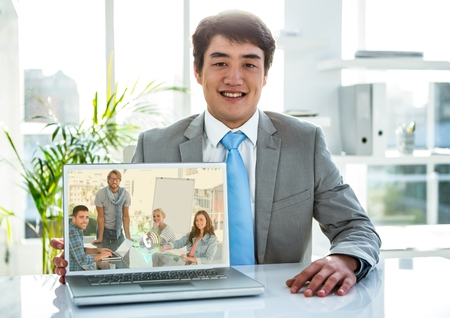 focus on foreground: Portrait of smiling businessman having video call on laptop in office