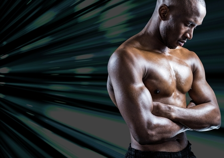 Muscular man standing with arms crossed against digitally composite background Stock Photo