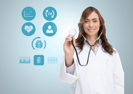 Portrait of smiling doctor showing stethoscope with icons on digital screen against white background