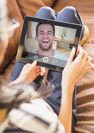 Woman having video calling on digital tablet at home Stock Photo