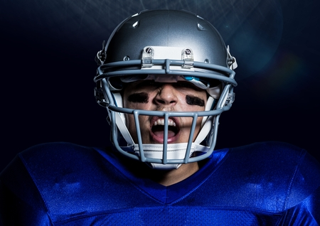 Digitally composite of aggressive american player in helmet Stock Photo