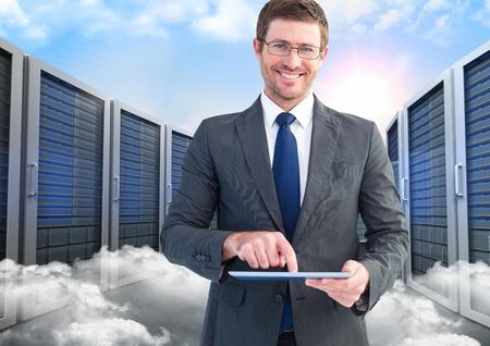 floorboards: Digitally composite of smiling businessman using digital tablet against server and clouds background
