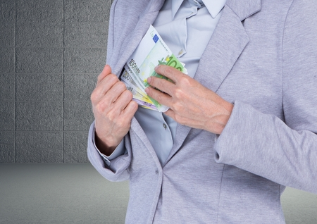 Digital composite image of a businessman keeping euro currency notes in inner pocket against grey background