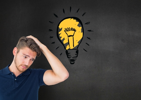 tablet pc in hand: Confused man standing next to glowing light bulb icon against grey background Stock Photo