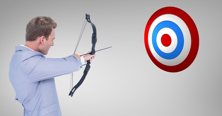 smart goals: Digital composite image of businessman aiming at the target board against grey background