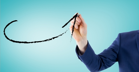 euphoria: Digital composite image of business professional drawing a arrow against blue background