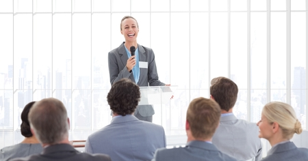 Businesswoman giving a speech in conference hall at office