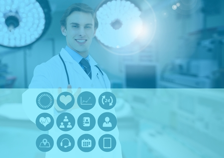 Male doctor touching medical icons on interface screen against digitally generated background Stock Photo