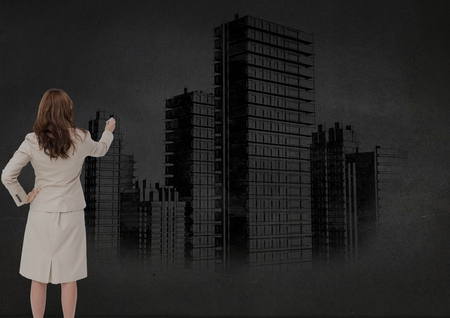 adult  body writing: Digital composite image of businesswoman drawing cityscape on wall