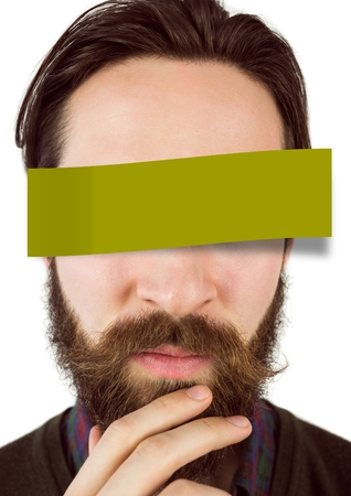 Confused man with adhesive note covering his eyes against white background