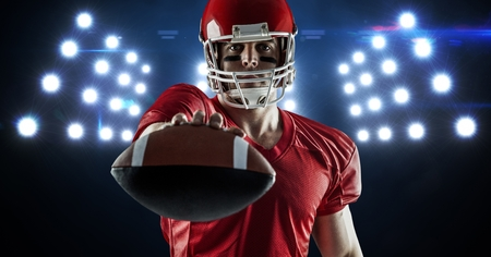 Digital composite image of american football player showing ball against spotlight