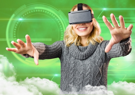 Smiling woman using virtual reality headset against digitally generated background