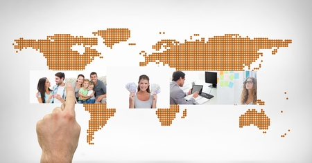 Hands touching digital pictures interface against world map on white background photo