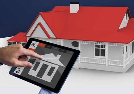 abode: Digital composite image of hands using digital tablet with home security icons Stock Photo