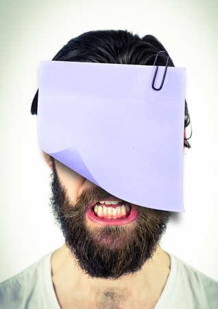 Digital composite image of man with a sticky note attached to his face