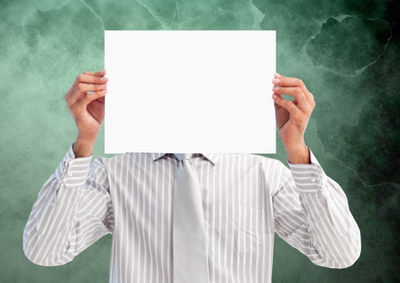 handholding: Digital composition of businessman holding blank placard in front of his face against green background
