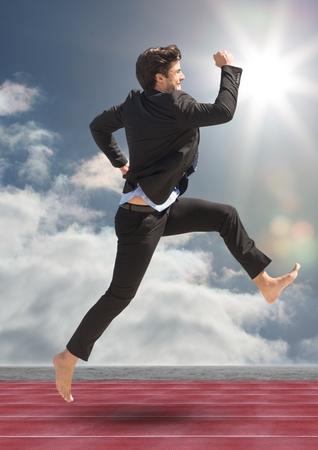 Digital composite image of businessman running on racing track