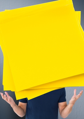 Composite image of man with large yellow sticky notes in front of face Stock Photo