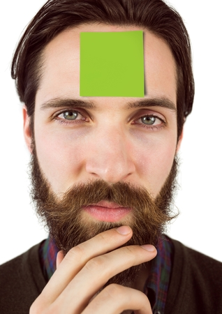 Close-up of businessman with blank sticky note on forehead standing against white background Stock Photo