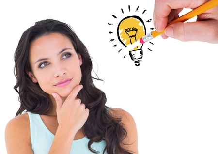 Digitally composite image of thoughtful woman looking at drawn innovation bulb against white background