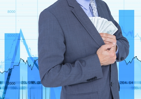 Mid section of corrupt businessman with money in pocket against graph in background