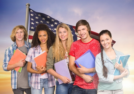 Digital composition of friends with books standing against american flag in background Stock Photo