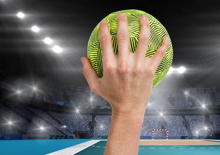 terrain de handball: composition numérique de l'athlète lançant handball contre le stade en arrière-plan