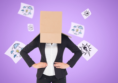 Digital composition of businesswoman with her face covered with cardboard box standing against innovation concepts in background Stock Photo