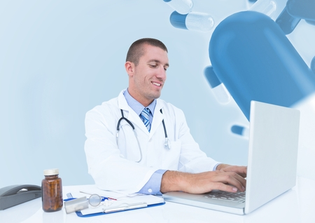 Digital composition of doctor using laptop against medical background Stock Photo