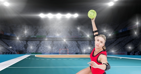 terrain de handball: Digital composition of athlete playing handball against stadium in background