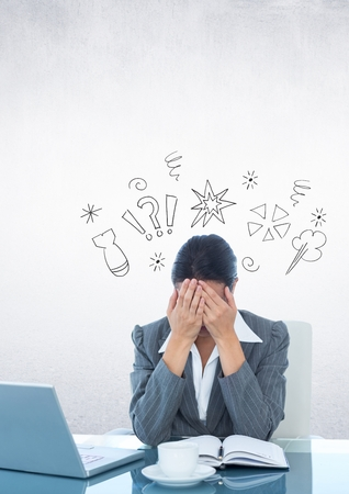 Digital composition of businesswoman sitting on her desk with hands on her face against thinking icons in background Stock Photo