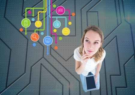 handholding: Digital composition of woman using digital tablet against application icons i background Stock Photo