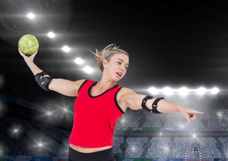 Digital composition of athlete playing handball against stadium in background