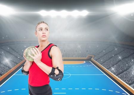 terrain de handball: composition numérique de l'athlète à jouer au handball contre le stade en arrière-plan