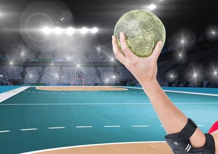 terrain de handball: Digital composition of athlete throwing handball against stadium in background