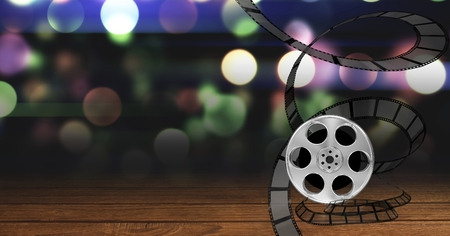 Digitally generated image of film reel against bokeh background Stock Photo