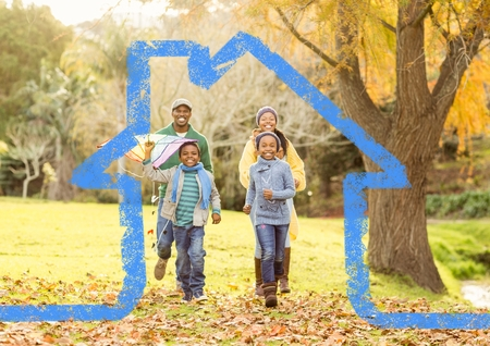 handholding: Digital composition of family running in the park against house outline in background Stock Photo