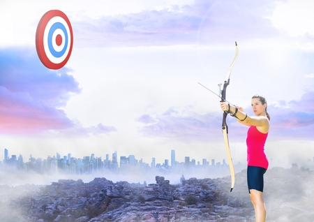 Digital composition of athlete aiming at the target board against cityscape in background